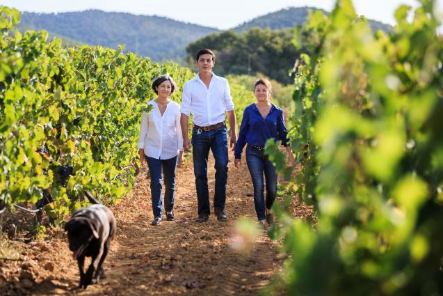 Combard Family walking through vineyard