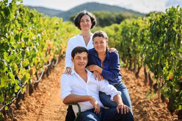 Combard Family in Vineyard Poising for Photo