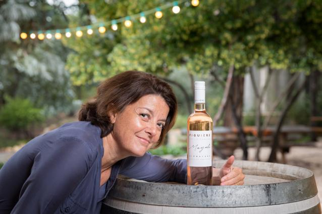 Magali Combard with rose wine bottle